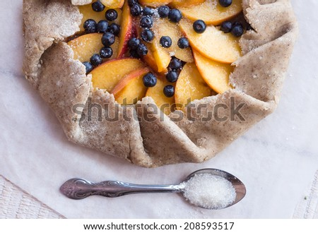 cooking biscuits with peach and blueberry, top view - stock photo
