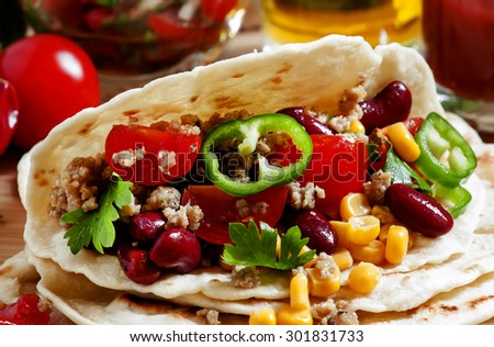 Cooking burritos, tortilla filling on the open, selective focus - stock photo