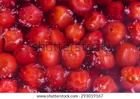 Cooking cherry jam from fresh cherries on a slow fire - stock photo