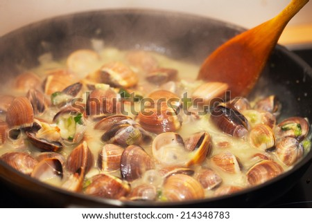 cooking clams, mussels - stock photo