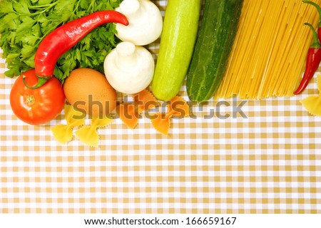 Cooking concept. Groceries on tablecloth background - stock photo