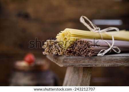 Cooking concept. Pasta with ingredients. Tomatoes,spaghetti, eggs and herbs - stock photo