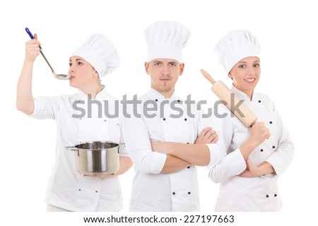 cooking concept - three young chefs isolated on white background - stock photo