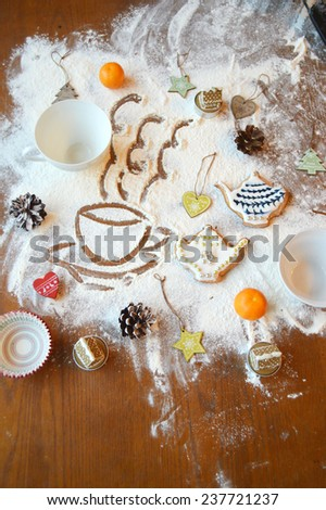 cooking, cooking Christmas ginger cookies, cupcakes. cookie cutters, deer, teapots .book recipes. the magic of Christmas kitchen - stock photo