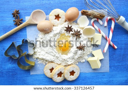 cooking, cooking Christmas ginger cookies, cupcakes. cookie cutters, deer, teapots .book recipes. the magic of Christmas kitchen.Christmas gingerbreads ingredients.Christmas cooking - stock photo
