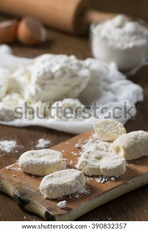Cooking. Cottage cheese, flour, egg. Ingredient for cheese pancakes. Ukrainian traditional food - stock photo