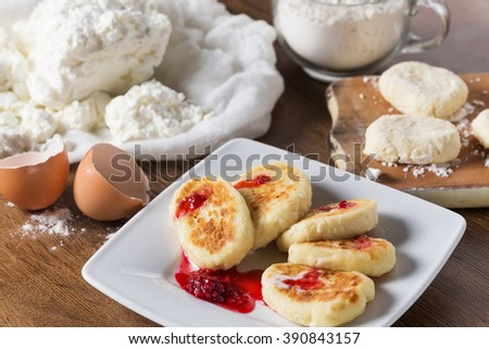 Cooking. Cottage cheese, flour, egg. Ingredient for cheese pancakes. Ukrainian traditional food. Selective focus - stock photo