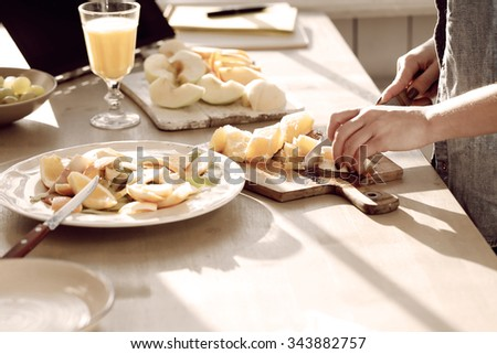 Cooking, cuisine. Woman prepare food at kitchen - stock photo