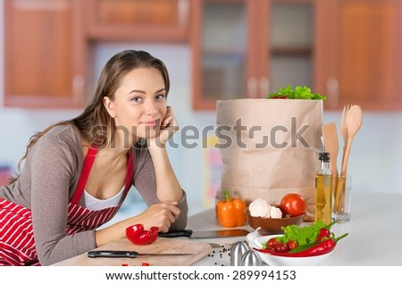Cooking, Domestic Kitchen, Women. - stock photo