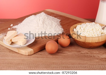 cooking dough on red - stock photo