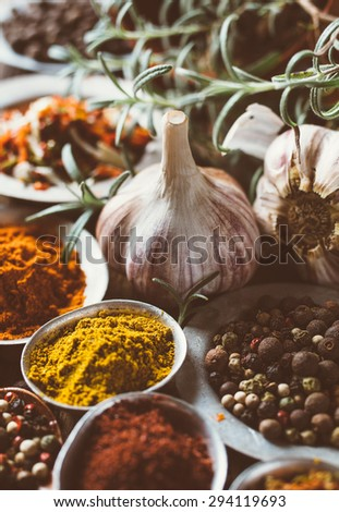 Cooking ingredients, spice in metal bowls. Toned image   - stock photo