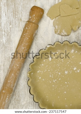 Cooking kit with rolling pin and pastry  - stock photo
