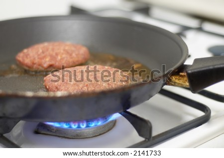 cooking meat on a stove - stock photo