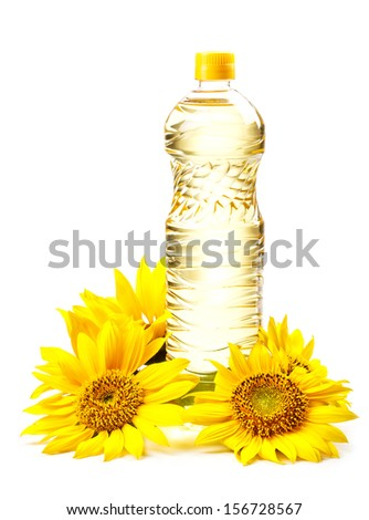 Cooking oil in a plastic bottle with sunflower - stock photo