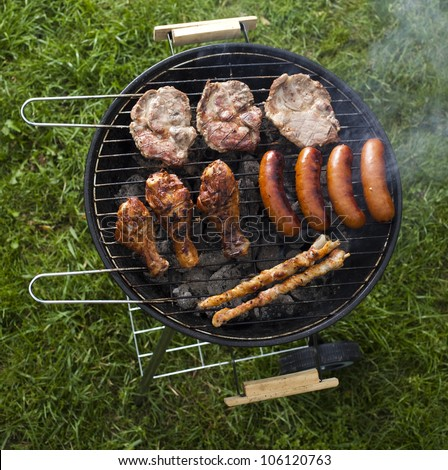 Cooking on the barbecue grill - stock photo
