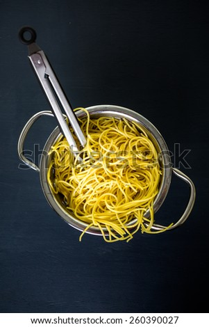 Cooking organic spaghetty for dinner. - stock photo
