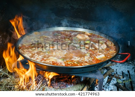 cooking paella - stock photo