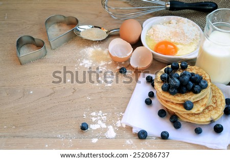 cooking pancakes with blueberries - stock photo