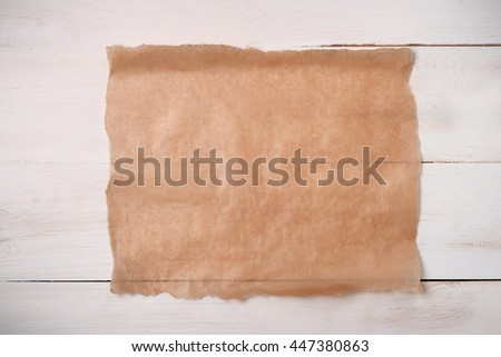 Cooking paper sheet on wooden board  - stock photo