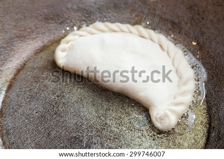 Cooking patty on frying pan with selective focus - stock photo