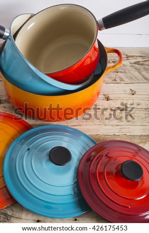 Cooking pots pans and lids - stock photo