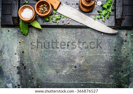 Cooking set with Kitchen knife with table spices, salt and pepper mills on rustic background , top view, place for text - stock photo