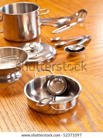 Cooking Spoon and Sauce Pan - stock photo