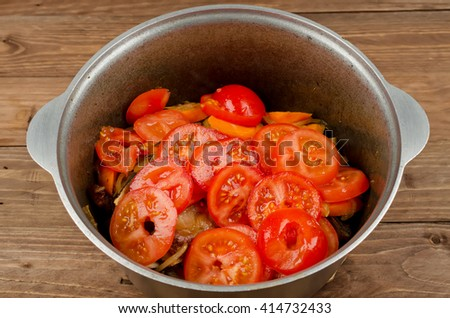 Cooking stew simmered with tender lamb meat, potatoes and vegetables. Domlama â?? Eastern soup with lamb and vegetables - stock photo