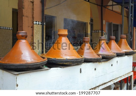 Cooking Tajine outdoors in Morocco - stock photo