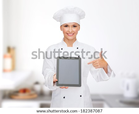 cooking, technology and food concept - smiling female chef, cook or baker with tablet pc computer blank screen - stock photo