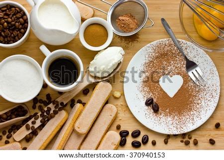 Cooking Tiramisu concept step by step. Homemade tiramisu cake. Ingredients for making perfect Italian dessert. I love tiramisu - stock photo