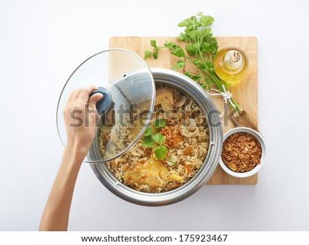 Cooking traditional nasi beriani malay style - stock photo