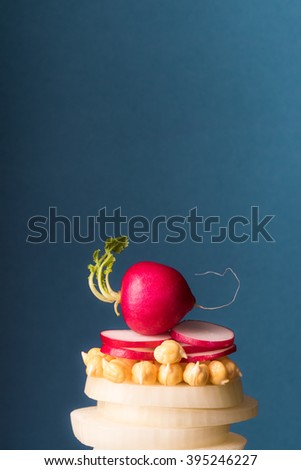 Cooking vegetable ingredients with chickpea beans, radish, onion. Healthy vegetarian food. - stock photo