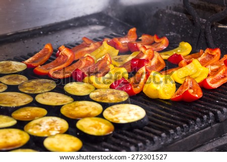 cooking vegetables on the grill in the kitchen at the restaurant - stock photo