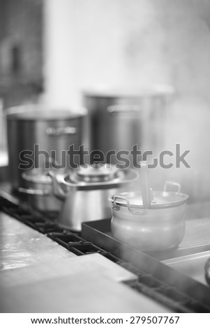 Cooking with stainless steel pans  - stock photo