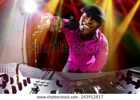 Cool African American male DJ playing music at a party - stock photo