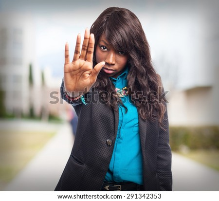 cool black-woman stop-gesture - stock photo