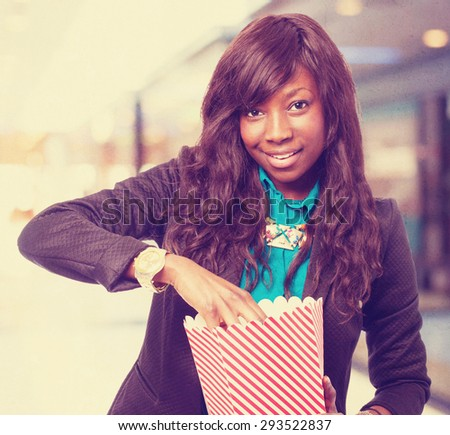 cool black-woman with popcorn - stock photo