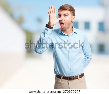 cool blond man joking - stock photo