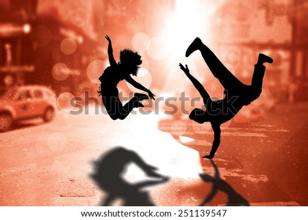 Cool break dancer against blurry new york street - stock photo
