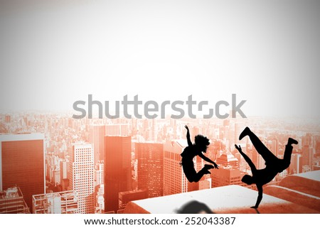 Cool break dancer against high angle view of city - stock photo