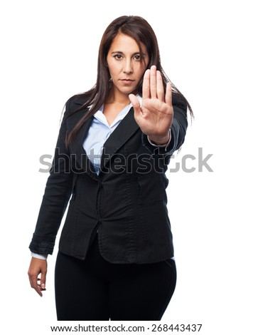 cool business woman stop gesture - stock photo