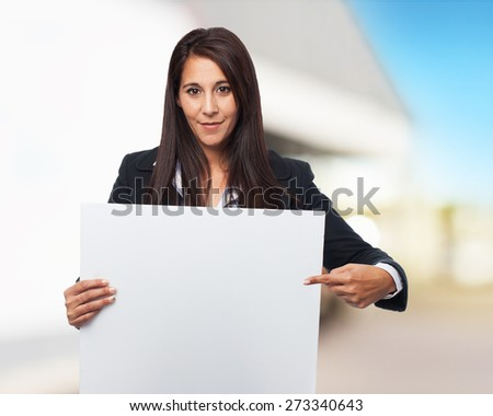 cool business-woman with banner - stock photo