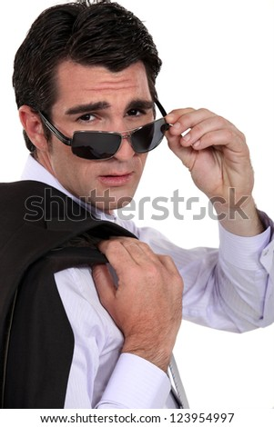 Cool businessman wearing sunglasses - stock photo
