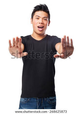 cool chinese-man stop-gesture - stock photo
