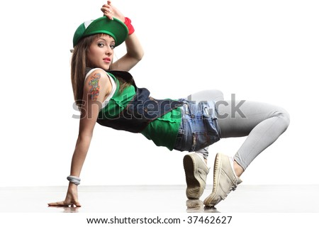 cool dancer poses in front of the white background - stock photo