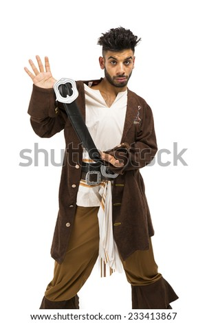 Cool Eastern European guy dressed in a brown pirate costume arms standing with one hand holding out his coat - stock photo