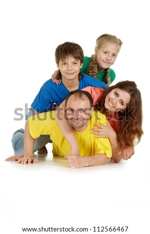 Cool family of four in bright T-shirt on a white background - stock photo