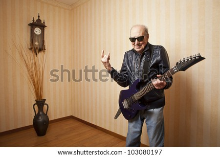 cool fashion elder man with electric guitar - stock photo