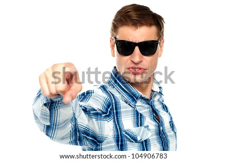 Cool fashionable guy pointing at you wearing sunglasses - stock photo